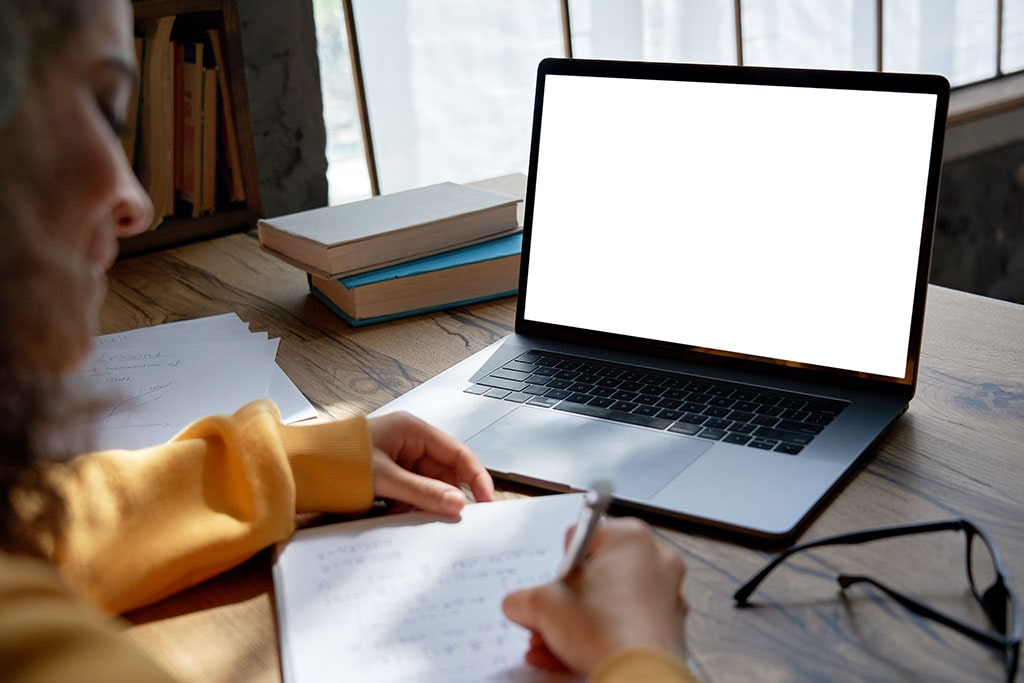 Hispanic girl using laptop