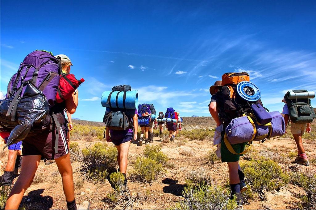 Group of people walking across mountain