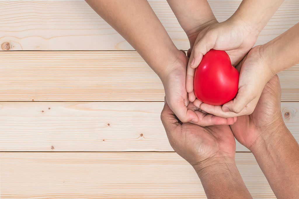 children holding hands with heart in the middle