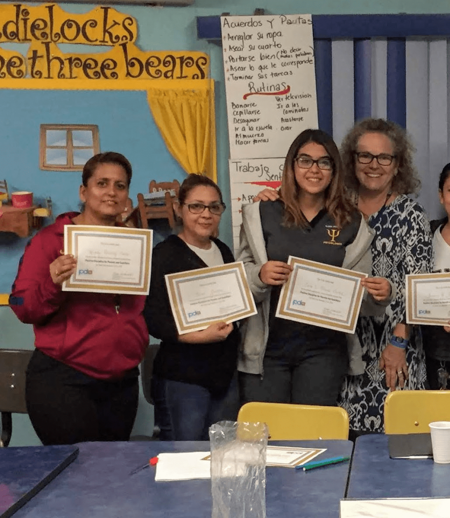Kirsten with the Tías of OLR who earned certificates of completion for the Positive Discipline training course
