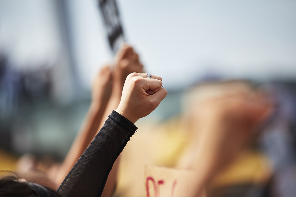 Women with fists up in the air