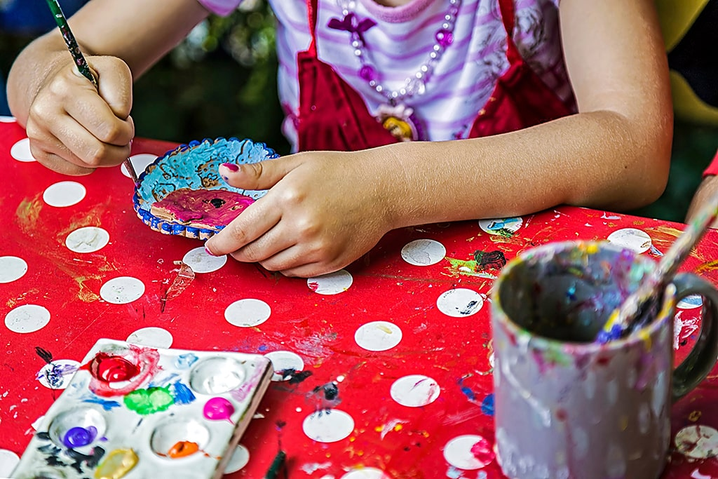 Child painting in a pottery workshop