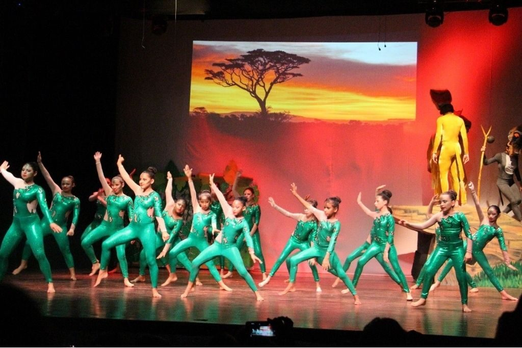 The girls performing a dance at a play