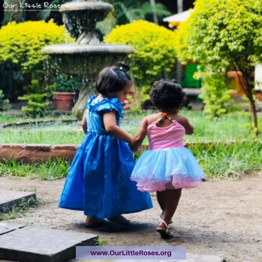 Two young girls playing together in Honduras