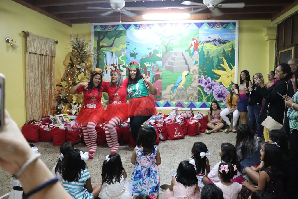 The girls at Our Little Roses dancing at a Christmas celebration