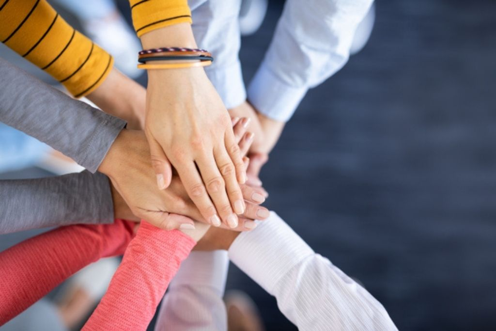 Groups of hands joined together
